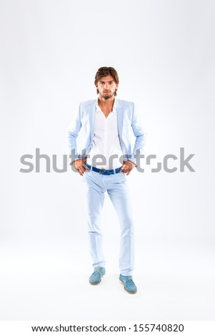Fashion men, male model wear blue suit, young man full length portrait over gray background - stock photo