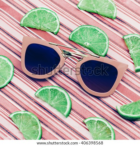 Fashion Mix. Stylish Pink Sunglasses and Lime. Fresh Summer Trend - stock photo