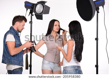 Fashion model at studio. Beautiful young female fashion model posing at photo studio - stock photo