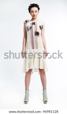 Fashion model beautiful woman wearing dress standing on podium - series of photos - stock photo
