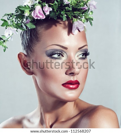 fashion model , beautiful woman , with flowers on her head , glamour make up