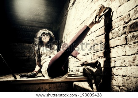 Fashion model brunette with long curly hair - stock photo