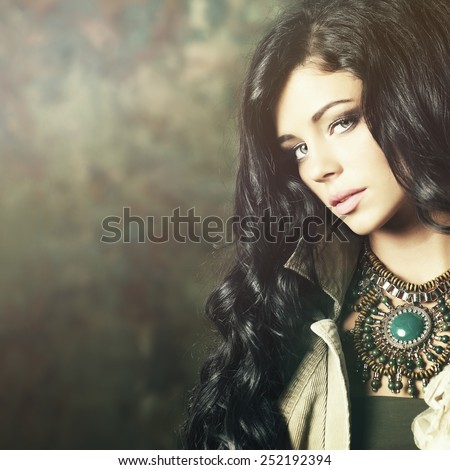 Fashion model brunette with professional makeup and long hair