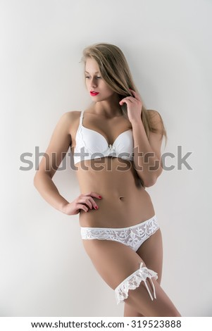 Fashion model demonstrates lingerie with garter
