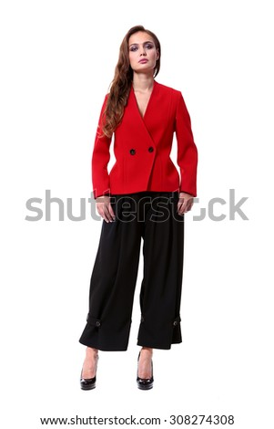 fashion model full length in red jacket and wide black trousers isolated on white - stock photo