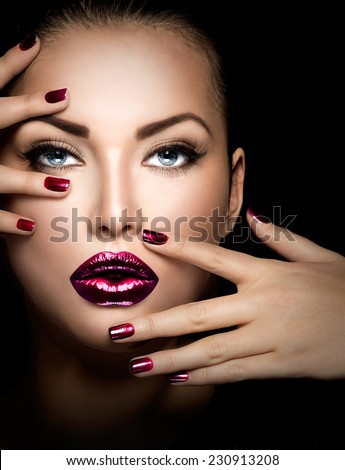 Fashion model girl face, beauty woman make up and manicure. Makeup closeup, perfect skin, manicured nails, deep violet color. Smoky eyes holiday luxury make-up, blue eyes  - stock photo