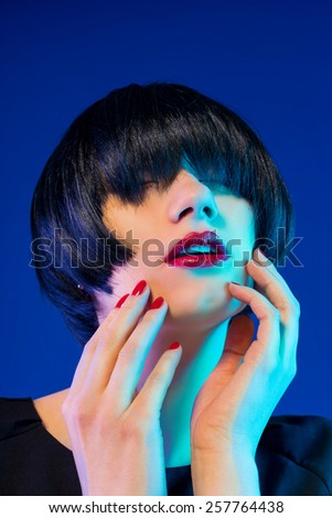 Fashion model girl face, beauty woman make up and red manicure. Bob black hairstyle.  - stock photo