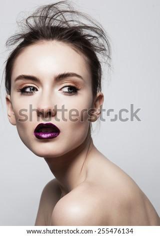 Fashion model girl face, beauty woman make up. Makeup closeup, perfect skin, deep violet color. Smoky eyes holiday luxury make-up, blue eyes,lashes - stock photo