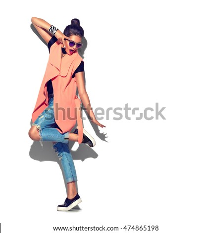 Fashion Model girl full length portrait isolated on white background. Beauty stylish brunette woman posing in fashionable clothes in studio. Casual style, beauty accessories. High fashion urban style