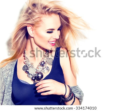 Fashion model girl portrait casual dressed, modern accessories - necklace and bracelets. Beauty young smiling woman, Blowing blond hair, fashion make up. Street fashion, urban style. Isolated on white - stock photo