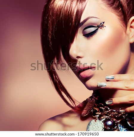 Fashion Model Girl Portrait. Trendy Hair Style. Short Haircut. Hairstyle. Beauty Woman Face closeup. Fringe. Hairdressing. Silver Metallic Accessories and Manicure. Red Hair coloring - stock photo