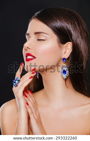 Fashion model girl portrait with blue earrings and ring. Woman with luxury accessories - stock photo
