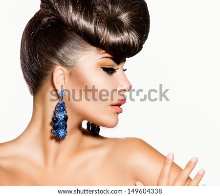 Fashion Model Girl Portrait with Blue Earrings. Creative Hairstyle. Hairdo. Make up. Beauty Woman isolated on a White Background  - stock photo