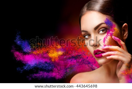 Fashion model girl portrait with colorful powder make up. Beauty woman with bright color makeup. Close-up of Vogue style lady face, Abstract colourful make-up, Art design. Black background - stock photo
