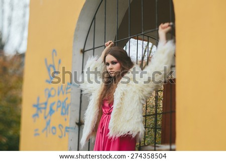 Fashion model in a dress at a photoshoot - stock photo