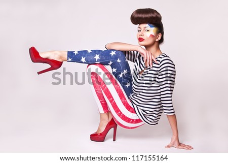 fashion model in american flag leggings with bright makeup - stock photo