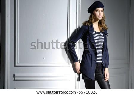 fashion model in autumn/winter clothes posing - stock photo
