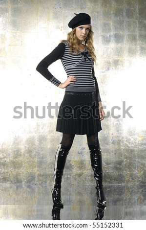 fashion model in autumn/winter clothes posing in the studio
