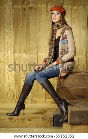 fashion model in autumn/winter clothes posing in the studio - stock photo