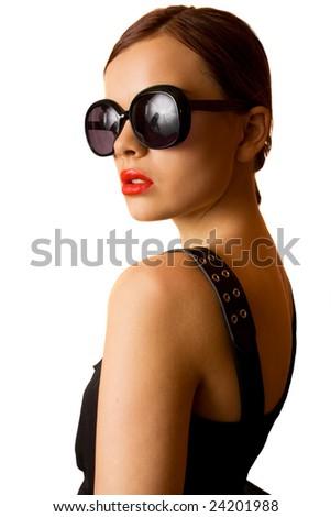 Fashion model in big eyeglasses posing - stock photo