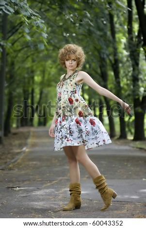 Fashion model in dress posing outdoors - stock photo