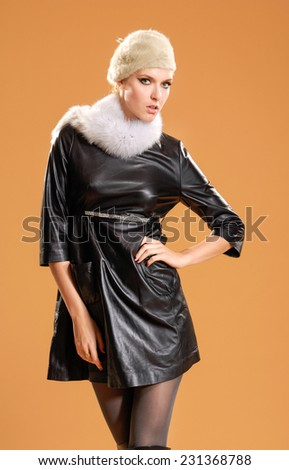 fashion model in fashion clothes posing in the studio - stock photo