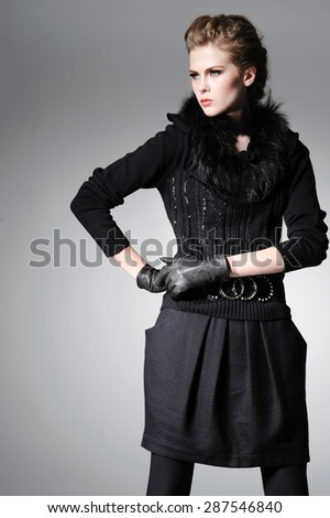 fashion model in gloves in light background - stock photo