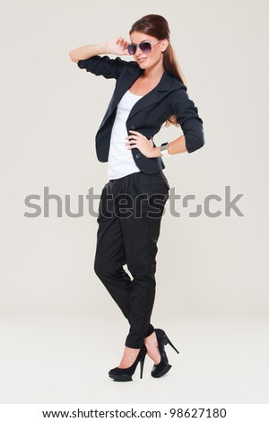 fashion model in studio. grey background - stock photo