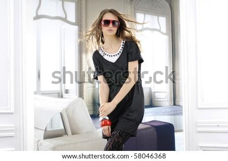 fashion model in sunglasses posing in the studio - stock photo