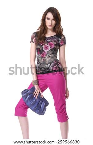 fashion model in sunglasses with handbag posing  - stock photo