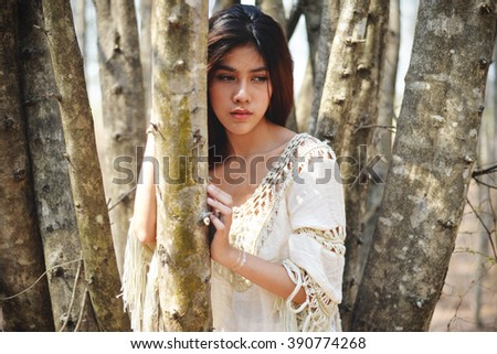 Fashion model in the forest. Portrait girl in vintage style - stock photo