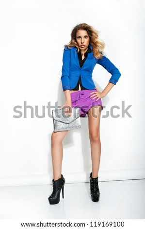 fashion model in violet shorts holding purse