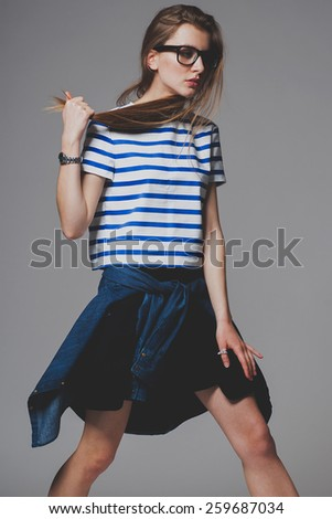 Fashion model life urban style posed in studio - stock photo
