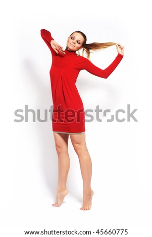 Fashion model on white studio background in red dress - stock photo