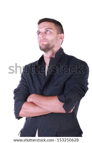 fashion model. Posing guy. Casual style. Good look. Young.  Standing on the white background.