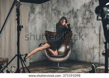 Fashion model posing in modern interior - stock photo
