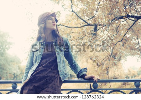 Fashion model posing in summer park - stock photo