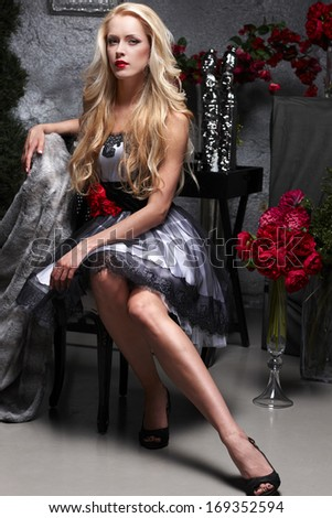 Fashion model posing in the chair - stock photo