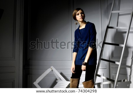 fashion model posing wooden ladder in the studio