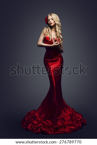 Fashion Model Red Dress, Stylish Woman in Elegant Beauty Gown, Girl Posing Slinky Evening Clothes in Studio - stock photo