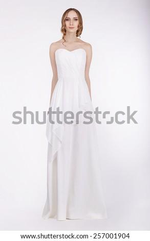 Fashion Model Standing in Long White Dress - stock photo