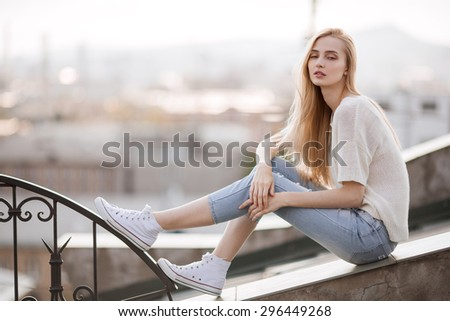 Fashion model. Summer look. Jeans, sneakers, sweater. - stock photo