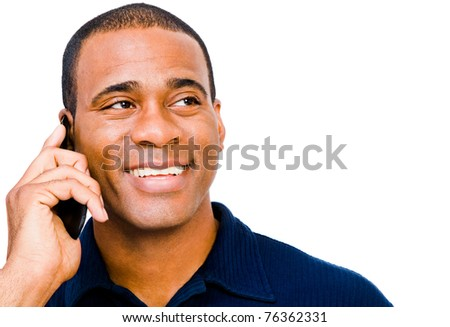 Fashion model talking on a mobile phone isolated over white