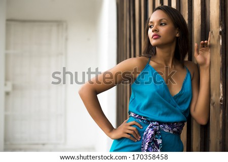 Fashion model wearing a blue dress - stock photo