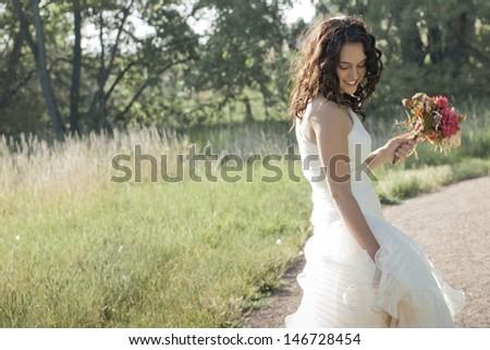 Fashion model wearing a wonderful  wedding dress. - stock photo