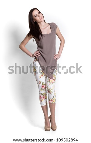 Fashion model wearing beige blouse with emotions - stock photo