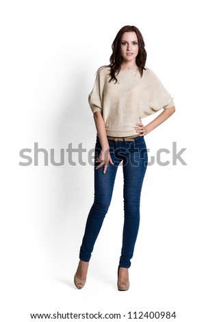 Fashion model wearing beige sweater with emotions - stock photo