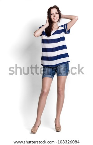Fashion model wearing blue and white blouse with emotions - stock photo