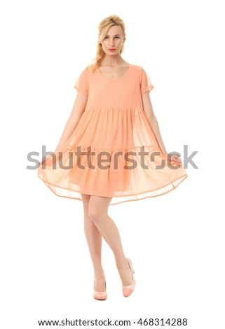 Fashion model wearing coral prom dress