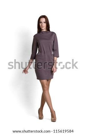 Fashion model wearing gray dress with emotions - stock photo